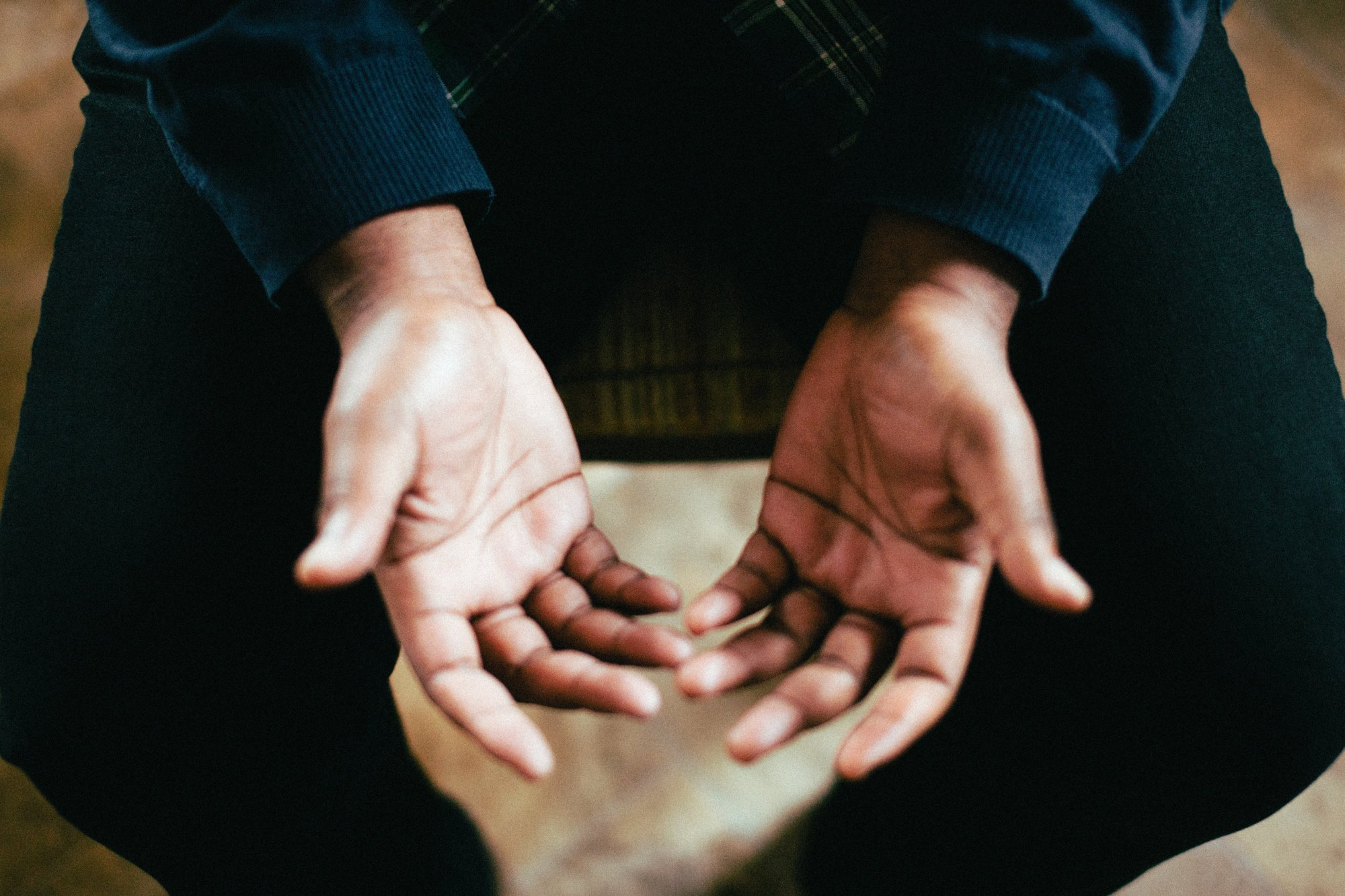 Hands open praying