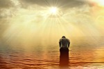 Man in water praying before God to show his thanks