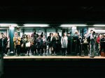 Photo of people waiting for the subway to represent the many people that suffer